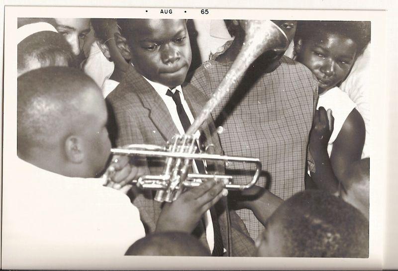 Boy trying dizzys horn