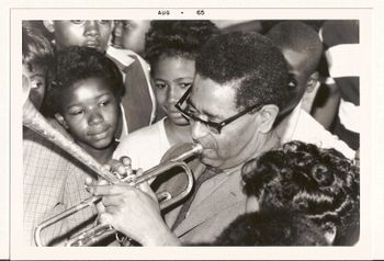 Dizzy with horn and children