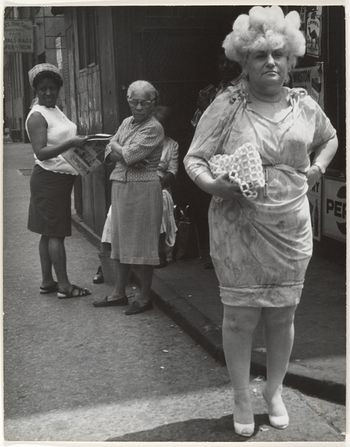 Street-scene-woman-in-blonde-wig-and-tight-dress-new-york-city-1960s