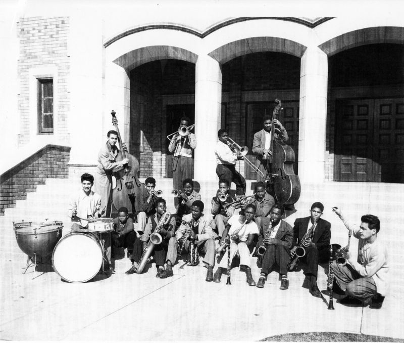 Anthony Ortega in 1947 at Jordan Junior and Senior High School conducting the Junior Hep Cats, wearing his senior sweater (full)