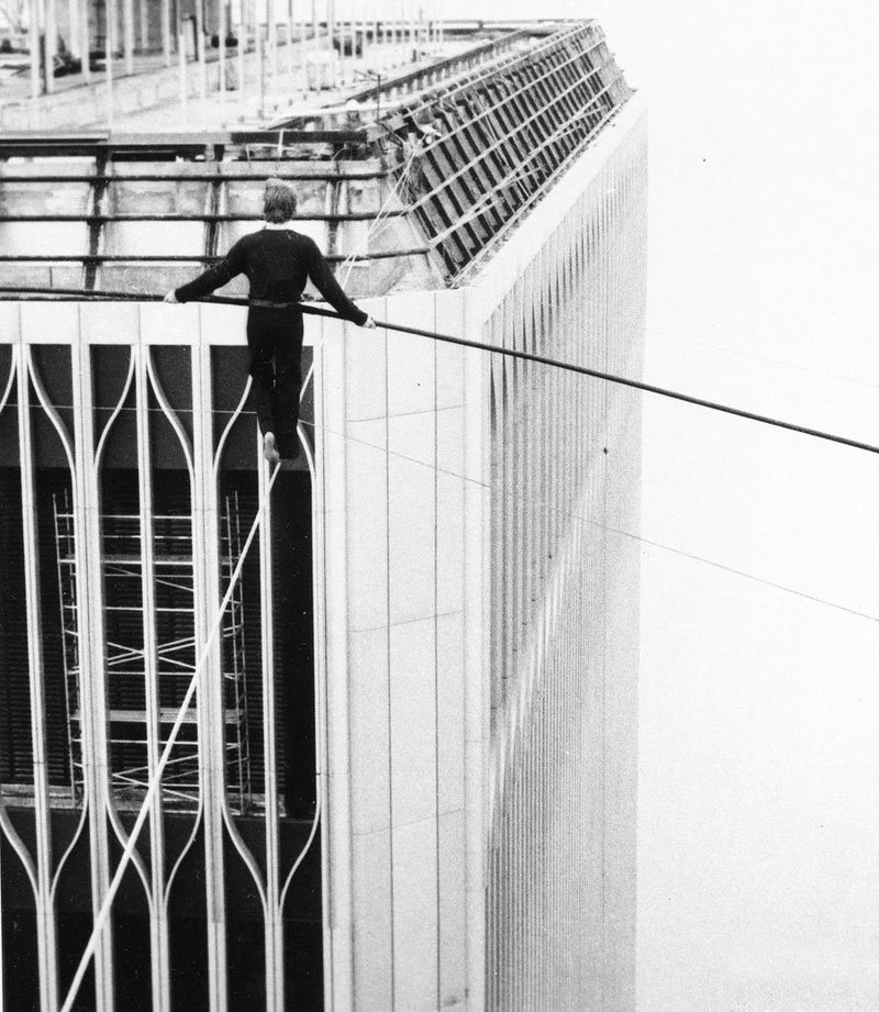 French-tight-rope-walker-philippe-petit-balances-as-he-walks-between-the-world-trade-center-when-he-was-done-police-officers-took-him-into-custody-august-7-1974