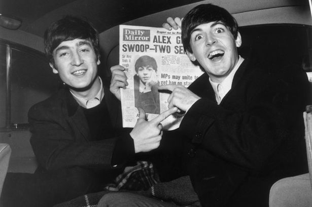 John Lennon & Paul McCartney with copy of Daily Mirror in November 1963-804303