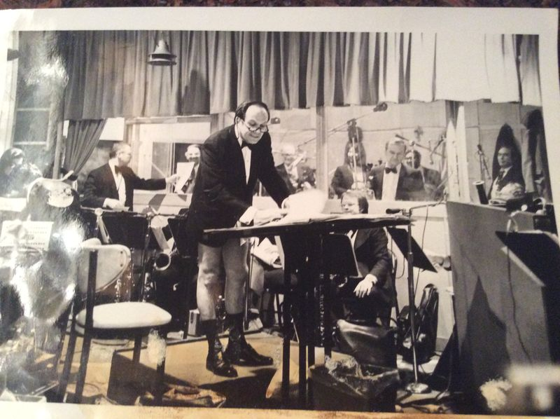 1960s pants got torn on mic stand and whil erepaired was taking notes for band. harp player sewing points.
