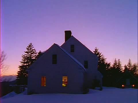 Country-house-with-lights-in-windows-in-snow-dusk-video-id351-17